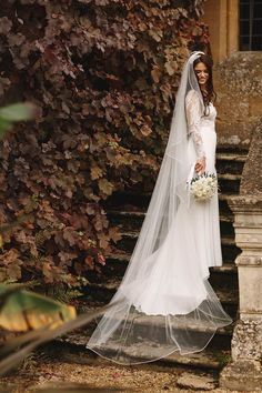 Bridal portrait in front of ivy covered wall White roses Long haired brunette bride Dress by Suzanne Neville Sudeley Castle Wedding Photography Image by ARJ Photography Wedding Wraps, Wedding Veils, Wedding Bride, Dream Wedding, Wedding Poses, Wedding Ideas, Suzanne Neville Wedding Dresses, Royal Weddings, Castle Weddings