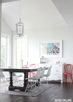 Cabin Tour and Life | Bright colored extra chairs frame the credenza