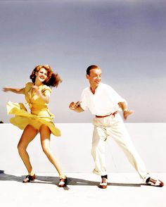 Rita Hayworth and Fred Astaire practicing the 'Shorty George' routine from You Were Never Lovelier on top of the studio roof, 1942