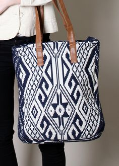 Pretty eco-friendly southwestern Aztec print design tapestry tote bag in thick premium cotton jacquard fabric shell coupled with either genuine leather or vegan leather shoulder strap options. Available in multiple color options coupled with a choice of genuine or vegan leather straps in tan color. Soft polyester lining inside in dark grey color, fully lined, one small side pocket inside. Large size, single compartment, plenty of room for all your essentials, multi-use. Magnetic snap…