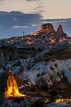 """These """"fairy castles"""" are actually sandstove cave homes from 2000 years ago, in Cappadocia, Turkey.     If you visit, be sure to stay in a cave hotel. If you can afford a balloon trip over this valley at dawn, you will never forget it."""