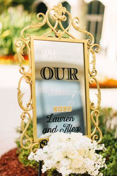Welcome Mirror Sign White Floral. Omni Orlando Resort at ChampionsGate Lauren & Alex. The Hons Photography. Floral by Lee James Floral Designs.