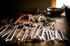 Ring spanners, mole grips, adjustables, pencil, screw drivers & pliers. It's a good start.