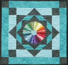 """Spectrum, 26 x 26"""", quilt pattern by Linda McGibbon at Lakeview Quilting."""