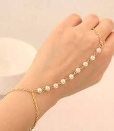 Find wide range of fashion jewellery imitation bridal artificial beaded and antique jewellery online. Buy imitation jewellery online from designers across India. Call us on [phone] now to resolve your queries. - June 08 2019 at Slave Bracelet, Bangle Bracelets, Hand Bracelet With Ring, Pearl Bracelet, Antique Jewellery Online, Jewelry Accessories, Jewelry Design, Hand Jewelry, Women's Jewelry