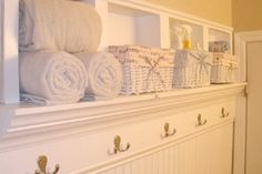 Good way to add storage to small bath. Looks great, too!