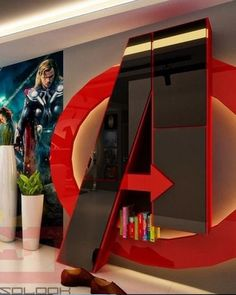"""We already know that Marvel gave Robert Downey Jr. the giant """"A"""" from the  Avengers tower, but for the rest of us who don't have Tony Stark money in  real life, this rad Avengers-themed house might be the closest we get to  living like a superhero. Or, in any case, living with the images of  superheroes surrounding you at any corner.  Absolook Interior Design is responsible for the decor here, and this looks  like a pretty kick-ass setup for any fan of Marvel's best hero squad. Check  out…"""