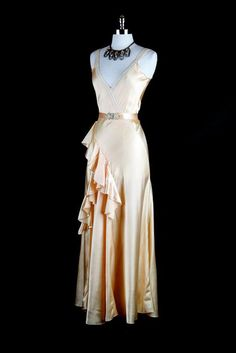 "Madeleine Vionnet was the person who created the Bias cut. I think this dress was inspired by the Greek. ""Pale pink 1930s bias cut gown with ruffles"" 