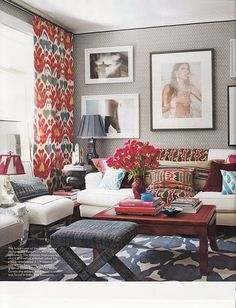 Love the mixed prints.  Mixing large scale colored textiles with small scale printed wallpaper in black and white keeps it from looking overly busy.  Very cool photography. Cozy living rooms space that looks chic but super comfortable.  (via Elle Decor)