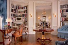At a 1912 McKim, Mead & White building in Manhattan, Alexa Hampton installed custom bookcases that curve with the walls of the oval library. Gracing the space is a jewel-like metal frieze, while the curtains and tufted love seats, covered in powder-blue cotton velvet, add a gentle dose of color.