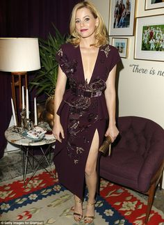 Thighly impressive: Elizabeth Banks showcased her perfect pins at the Glamour Women Of The...