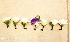purple themed wedding, boutineers for groom and groomsmen.