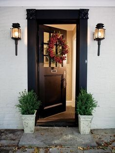 Entry. Molding, unique door, balance lighting and plants.  Like this idea to make the door bigger Wonder if this would look OK added to the front?