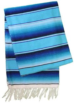 This is a traditional Mexican Sarape Serape Blanket. Used by many as a yoga mat, but also makes a great blanket to use at the beach or on the couch on a lazy d