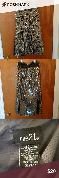 Gold/Silver Sequin Party Dress This sequin dress would be perfect for New Year's Eve or a night out! The sequins are a cross between gold and silver, very pretty! Like new, only worn once. From a smoke free home. Rue21 Dresses Strapless