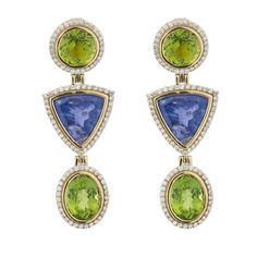 Luxor - Tanzanite Peridot Diamond Earrings. Approximately 20.47 carats of Tanzanite and 17.40 carats of Peridot surrounded with 1.81 carats of brilliant Diamonds set in 18K Yellow Gold make for the perfect earrings for any occasion. The use of simple shapes and detailed finishes create perfect frames for the Tanzanite and Peridot stones, accentuating their aesthetic beauty.