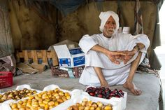 Bahraini old man in his shop selling dates.