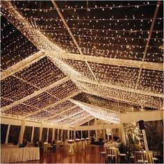 a lot of Christmas Lights on the ceiling creates a gorgeous starry skies for your winter wedding