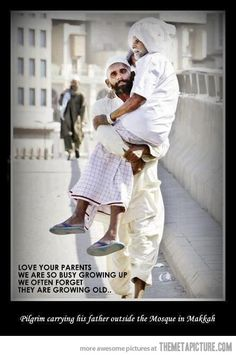 Pilgrim carrying his father outside the Mosque in Makkah