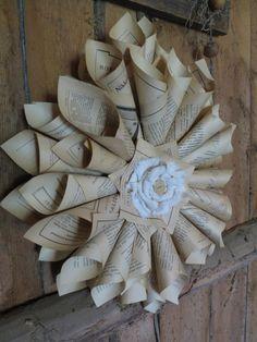 paperikukkanen vanhoista kirjanlehdistä