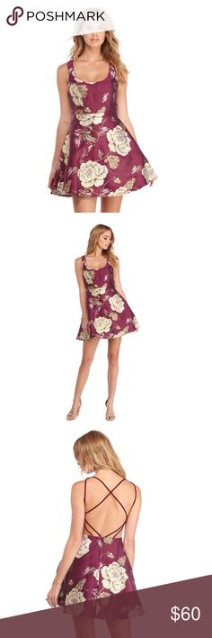 Emerie Burgundy Metallic Cross Back Dress features a sleeveless bodice and a deep scoop neck paired with wide shoulder straps. Her bodice features heavily padded cups and flattering princess seams for a tailored look! Her waist leads to a playful skater length skirt with hidden side pockets. Her all over gold metallic roses reflect the spotlight against a deep burgundy shade. Emerie is composed of a thick woven fabric that offers a form fit with little to no stretch. She is fully lined and…