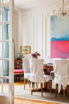 Love the large artwork in this dining room
