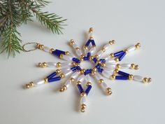 Christmas ornament star made from seed beads by Kreativprodukte