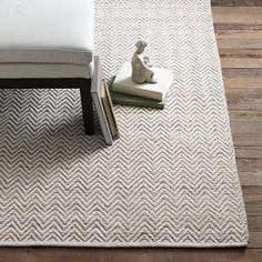 Love this rug. Neutral with chevron textured pattern from West Elm.
