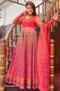 Look elegant when wearing this pink chanderi anarkali suit which makes you appealing. This sweetheart neckline and full sleeve clothe designed with digital print work. Available with lycra churidar in pink color with tomato red chanderi dupatta. Churidar has plain. #anarkalisuit #usa #Indianwear #Indiandresses #andaazfashion