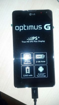 My brand new LG Optimus G, getting ready. Charhing battery for the first time