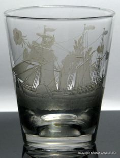 Georgian Steam Frigate Ship Engraved Glass Tumbler which dates to around 1820.  It has a tapering cylindrical form with a superb Steam Frigate engraved on one side and on the reverse a Union Spray of a Scottish Thistle, English Rose and Irish Shamrocks. Polished pontil to the base.   http://scottishantiques.com/georgian-glass/tankard-tumbler/antiquetumbler#.VjN7RNLhBeh