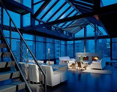 A stunning downtown Seattle penthouse living room completed by Toth Construction. #luxePNW