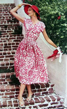 1954 floral print dress full skirt day wear casual summer vintage fashion style 50s color photo print ad model magazine red white hat purse shoes