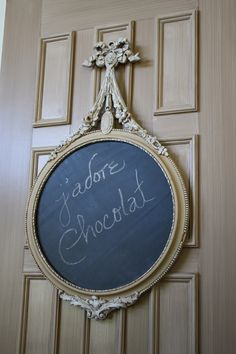 Love this frame made into a chalkboard..... And what it says (FYI it says: I love chocolate)