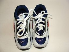 Beautiful pair of boy tennis shoes    BRAND NEW in box!    From: NIKE    Color: White, Blue, Gray and Red    Size: 8.5 (Toddler)