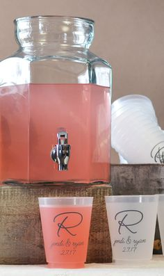 Plastic glassware custom printed with the bride and groom's names and initial or with a complimenting wedding design and a fun way to serve drinks at your wedding reception beverage station or bar. Disposable plastic glasses make for easy cleanup. Reusable plastic wedding glassware can be taken home by guest to be used again and again. Consider personalized reusable wedding cups as wedding takeaways guests will keep as mementos of your special day.