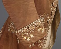 Detail cuff, court coat, 18th century. Brown silk faille, lavishly decorated with floral embroidery in white and pastel tones, self fabric buttons, lined in ivory silk and linen.