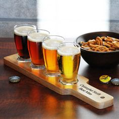 Develop an astute pallet for the complex flavors and aromas that different beers offer with our personalized beer flight set. This elegant beer glasses set features four beer sampler glasses and a natural finish wood flight sampler paddle with four perfec Drinkware, Barware, Glace Fruit, Beer Sampler, Beer Tasting Parties, Craft Bier, Wooden Paddle, Brew Pub, Beer Mugs