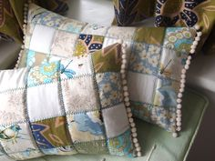 My new bedroom cushions. Quilted patchwork finished with bobble trim.