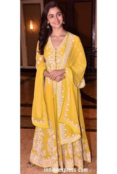 Recently, at the success party of Raazi, we spotted Alia Bhatt in a butter yellow anarkali piece from designer duo Abu Jani and Sandeep Khosla. She kept her look easy and toned down. Dress Indian Style, Indian Dresses, Ethnic Outfits, Indian Outfits, Indian Attire, Indian Wear, Ethnic Fashion, Indian Fashion, Indian Cocktail Dress