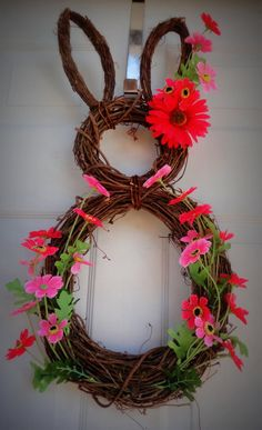 Easter Wreath Idea. Pinned by Afloral.com from http://www.familyholiday.net/awesome-spring-and-easter-ideas-to-spruce-up-your-porch ~Afloral.com has high-quality faux flowers and wreath supplies for your DIY Easter decorations.