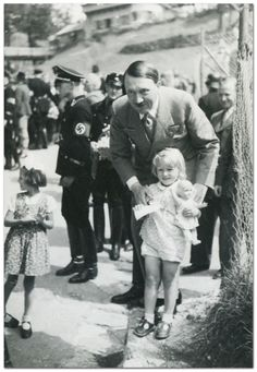fuehrerbefehl: Hitler getting a photo taken with a blonde girl