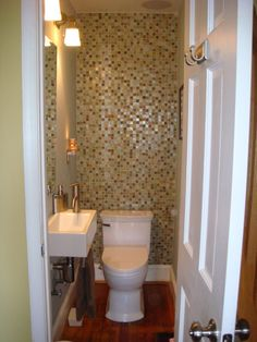 Of my bathroom the toilet is in its own little closeted room, this is a good idea, To do the back wall in the same tile we do around the tube....
