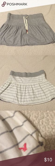 Reversible skirt Soft skirt from American eagle; no tags but fits like a medium; reversible from plaid grey to striped!! American Eagle Outfitters Skirts