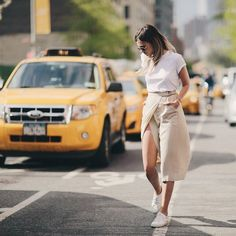 Pin for Later: 24 Reasons to Unfollow All Your Favorite Fashion Bloggers Immediately You'll Take Risks and Try New Silhouettes A thigh-high slit doesn't seem as revealing when it's paired with a plain white tee and low-tops. Say goodbye to your comfort zone!
