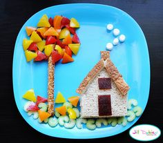 from meet the dubiens      House - chicken sandwich cut into house shape and crusts cut off - use crusts to make roof and chimney on house - fruit leather door and window and marshmallows coming out the chimney    Tree - pretzel stick with cut coloured peppers, coloured peppers and sliced celery on the ground for grass.