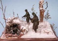 1/35 Diorama showing a scene from the Battle of the Bulge.  The German is surprised                                                                                                   and surrounded.