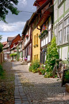 Old Village Quedlinburg by Heiko Koehrer-Wagner : German Old Village Quedlinburg by Heiko Koehrer-Wagner : Piotrkowska street on a sunny morning in Łódź, Poland © Avillfoto / Shutterstock Street with old decorative houses in Goslar, Lower Saxony, Germany Beautiful Places In The World, Places Around The World, Oh The Places You'll Go, Wonderful Places, Places To Travel, Places To Visit, Around The Worlds, German Architecture, German Village