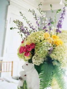 To create a large floral centerpiece for your Easter table, carefully crumple chicken wire into a loose ball, fit it inside a vase, and poke the flowers, stem by stem, through the holes in the wire. For maximum impact and the most natural look, gather the blooms into clusters of like flowers. Search for creative Easter containers to house your flower creations.