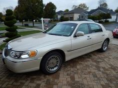 2001 Lincoln Town Car,Cartier, certified, One owner sold at a MaxSold Kingston Ontario, Canada Downsizing Auction $8900